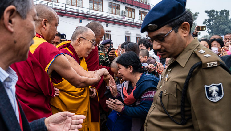 His Holiness the Dalai Lama greeting greeting friends and well-wisher as he walks to the Mahabodhi Temple in Bodhgaya, Bihar, India on December 17, 2018. Photo by Tenzin Choejor