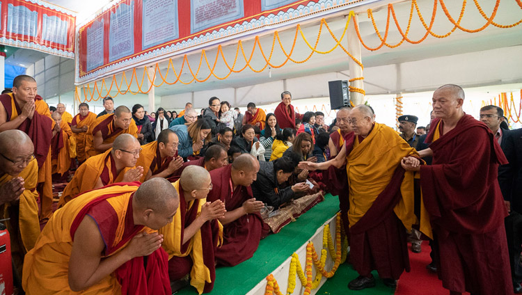 His Holiness the Dalai Lama greeting friends and waving to members of the audience as he arrives at the Kalachakra Ground in Bodhgaya, Bihar, India on December 24, 2018. Photo by Lobsang Tsering