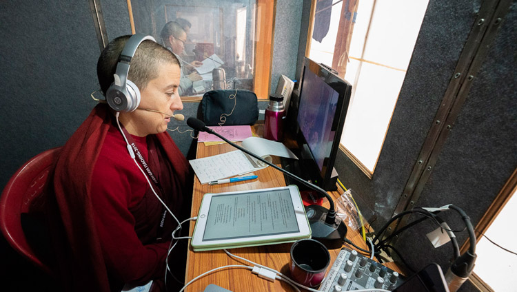 The Spanish interpreter, one of 13 languages being translated, working in her translation booth on the first day of His Holiness the Dalai Lama's teaching in Bodhgaya, Bihar, India on December 24, 2018. Photo by Lobsang Tsering