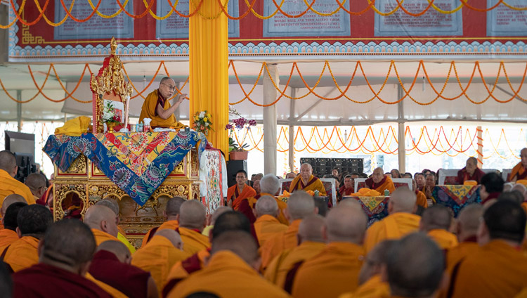 His Holiness the Dalai Lama explaining verses of 'The Thirty-seven Practices of Bodhisattvas' on the first day of his teachings in Bodhgaya, Bihar, India on December 24, 2018. Photo by Lobsang Tsering