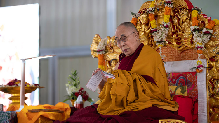 His Holiness the Dalai Lama reading from '37 Practices of Bodhisattvas' on the second day of his teachings in Bodhgaya, Bihar, India on December 25, 2018. Photo by Lobsang Tsering