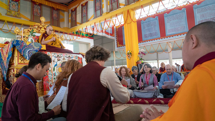Westerners singing the 'Heart Sutra' in English at the start of the Solitary Hero Vajrabhairava Empowerment given by His Holiness the Dalai Lama in Bodhgaya, Bihar, India on December 26, 2018. Photo by Lobsang Tsering