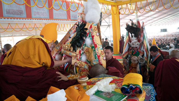 His Holiness the Dalai Lama and Nechung Dorje Drakden with the oracle of Nyenchen Thangla behind during the Long Life Ceremony at the Kalachakra Ground in Bodhgaya, Bihar, India on December 31, 2018. Photo by Lobsang Tsering