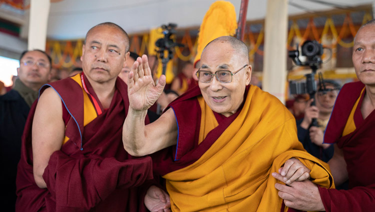 His Holiness the Dalai Lama waving to the crowd as he leaves the stage at the conclusion of the Long Life Ceremony at the Kalachakra Ground in Bodhgaya, Bihar, India on December 31, 2018. Photo by Lobsang Tsering