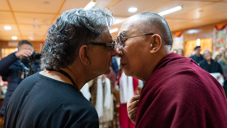 His Holiness the Dalai Lama greeting Deepak Chopra in the Maori style of rubbing noses at the start of their meeting at his residence in Dharamsala, HP, India on February 11, 2019. Photo by Tenzin Choejor