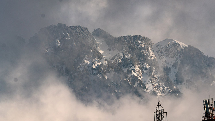 Fresh snow on the mountains behind Dharamsala on the morning of the Day of Miracles in Dharamsala, HP, India on February 19, 2019. Photo by Tenzin Choejor