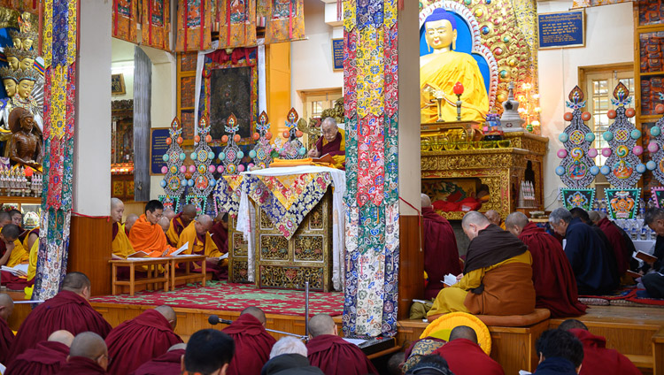 His Holiness the Dalai Lama reading from the texts during his teaching at the Main Tibetan Temple on the Day of Miracles in Dharamsala, HP, India on February 19, 2019. Photo by Tenzin Choejor