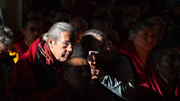 Members of the crowd listening to a translation of His Holiness the Dalai Lama's teaching at the Main Tibetan Temple in Dharamsala, HP, India on February 19, 2019. Photo by Tenzin Choejor
