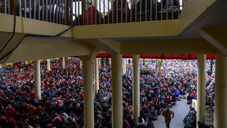 A view of the courtyard of the Main Tibetan Temple, full of people listening to His Holiness the Dalai Lama's teaching on the Day of Miracles in Dharamsala, HP, India on February 19, 2019. Photo by Tenzin Choejor