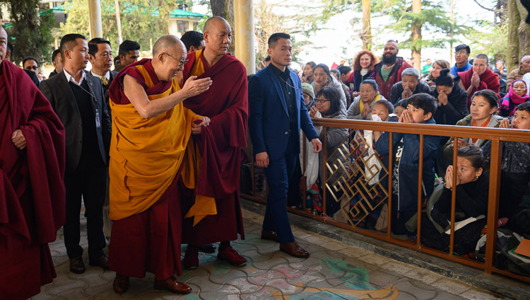 "His Holiness the Dalai Lama greeting members of the crowd in the Main Tibetan Temple courtyard on the first day of his teaching on Bhavaviveka's ""Essence of the Middle Way"" in Dharamsala, HP, India on February 20, 2019. Photo by Tenzin Choejor"