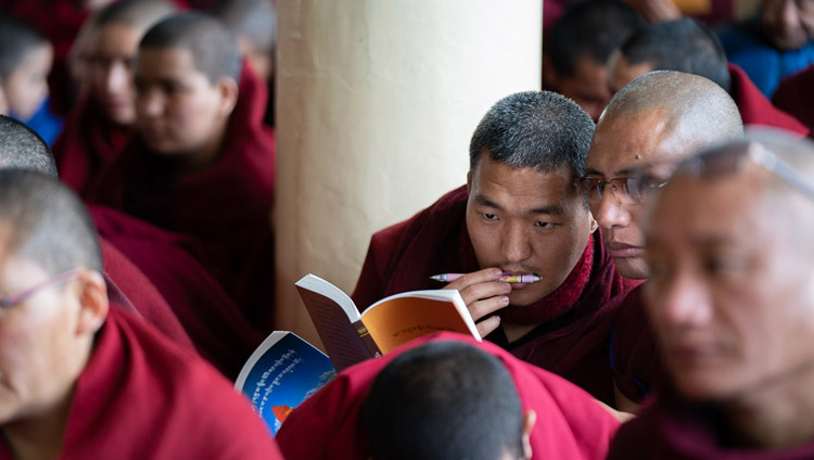 "Monks in the audience following the text as His Holiness the Dalai Lama reads from Bhavaviveka's ""Essence of the Middle Way"" on the first day of his teachings at the Main Tibetan Temple in Dharamsala, HP, India on February 20, 2019. Photo by Tenzin Choejor"