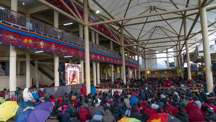 The crowd sitting in the courtyard of the Main Tibetan Temple watching His Holiness the Dalai Lama on big screens on the second day of his teaching in Dharamsala, HP, India on February 21, 2019. Photo by Tenzin Choejor