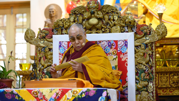 "His Holiness the Dalai Lama reading from Bhavaviveka's ""Essence of the Middle Way"" at the Main Tibetan Temple in Dharamsala, HP, India on February 22, 2019. Photo by Pasang Tsering"