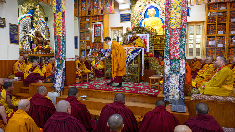 His Holiness the Dalai Lama explaining Manjushri Permission he will give on the final session of his teachings at the Main Tibetan Temple in Dharamsala, HP, India on February 23, 2019. Photo by Tenzin Choejor
