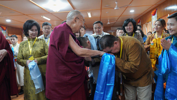 His Holiness the Dalai Lama greeting members of a group of young professionals from Mongolia as he arrives for their meeting as his residence in Dharamsala, HP, India on March 25, 2019. Photo by Tenzin Choejor