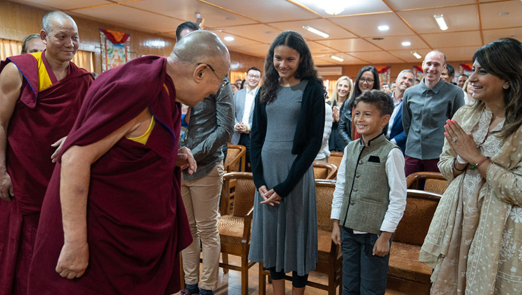 His Holiness the Dalai Lama greeting one of the younger members of a group from Singapore on his arrival for the meeting at his residence in Dharamsala, HP, India on March 27, 2019. Photo by Tenzin Choejor