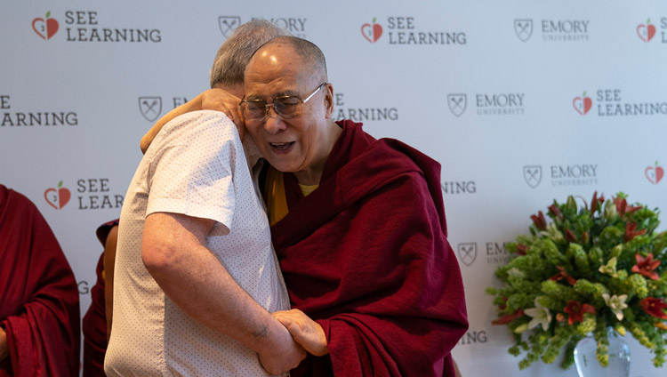 His Holiness the Dalai Lama greeting his old friend Richard Moore on his arrival for the press conference for the global launch of SEE Learning in New Delhi, India on April 4, 2019. Photo by Tenzin Choejor