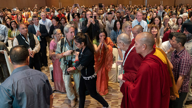 His Holiness the Dalai Lama arriving at the meeting hall for the unveiling of the SEE Learning curriculum in New Delhi, India on April 5, 2019. Photo by Tenzin Choejor