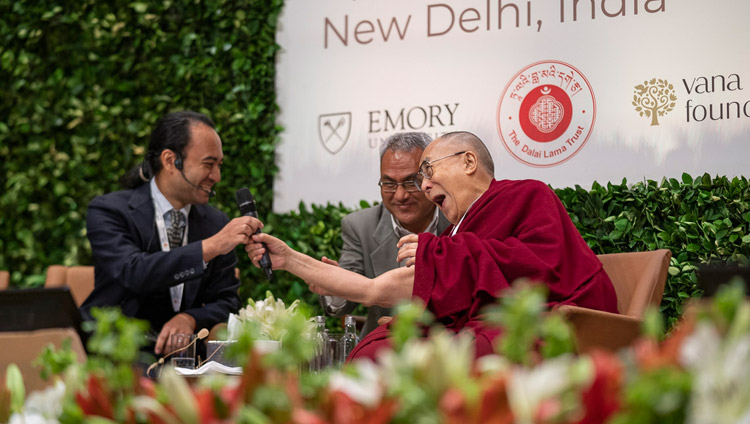 His Holiness the Dalai Lama playfully handing Brendan Ozawa-de Silva his microphone during the panel discussion at the global launch of SEE Learning in New Delhi, India on April 5, 2019. Photo by Tenzin Choejor