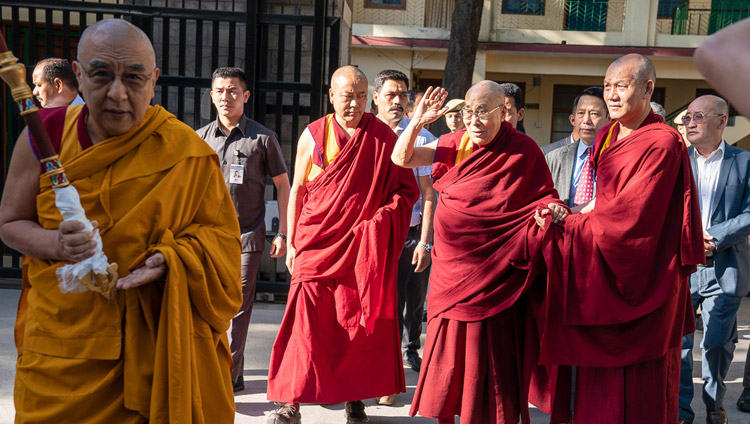 His Holiness the Dalai Lama waving to well-wishers gathered to greet him in the Main Tibetan Temple courtyard as he makes his way to the Kalachakra Temple in Dharamsala, HP, India on May 5, 2019. Photo by Tenzin Choejor