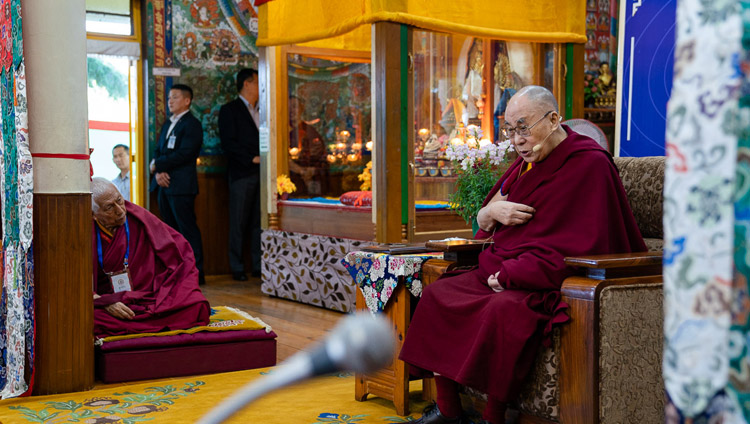 Samdhong Rinpoche looks on as His Holiness the Dalai Lama delivers his opening remarks at the First Conference on Kalachakra at the Kalachakra Temple in Dharamsala, HP, India on May 5, 2019. Photo by Tenzin Choejor