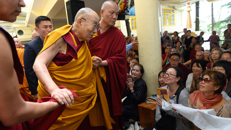His Holiness the Dalai Lama greeting members of the audience as he leaves at the end of the first day of his teachings at the Main Tibetan Temple in Dharamsala, HP, India on May 10, 2019. Photo by Tenzin Choejor