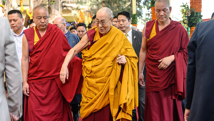 His Holiness the Dalai Lama walking through the courtyard on the way to the Main Tibetan Temple to attend an offering of prayers for his long life in Dharamsala, HP, India on May 17, 2019. Photo by Tenzin Choejor