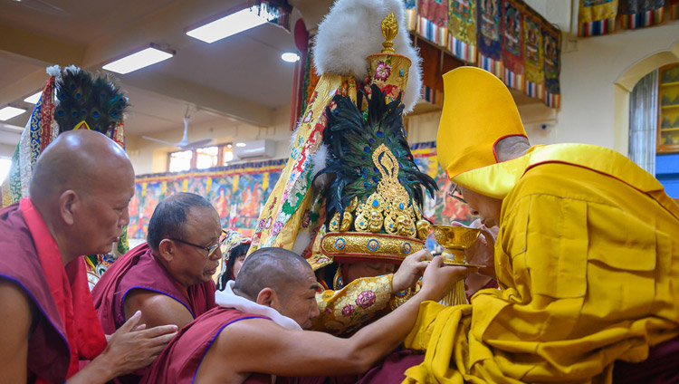 The Nechung Oracle offering ritual substances for the long life of His Holiness the Dalai Lama at the Main Tibetan Temple in Dharamsala, HP, India on May 17, 2019. Photo by Tenzin Choejor