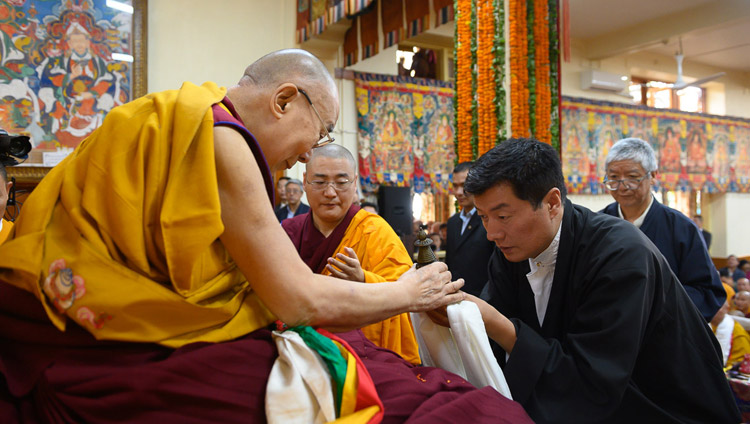 President of the Central Tibetan Administration Dr Lobsang Sangay offering a white scarf to His Holiness the Dalai Lama during the Long Life Offering Ceremony for His Holiness at the Main Tibetan Temple in Dharamsala, HP, India on May 17, 2019. Photo by Tenzin Choejor
