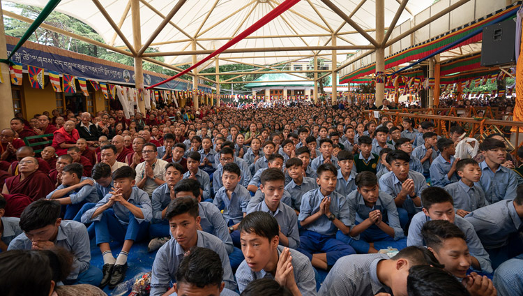 Young Tibetan students sitting in the Main Tibetan courtyard watching the Long Life Offering Ceremony for His Holiness the Dalai Lama on big screens in Dharamsala, HP, India on May 17, 2019. Photo by Tenzin Choejor