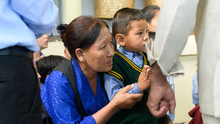 Young and old members of the Tibetan community watching as His Holiness the Dalai Lama arrives at the Main Tibetan Temple for his teaching for young Tibetans in Dharamsala, HP, India on June 3, 2019. Photo by Tenzin Choejor