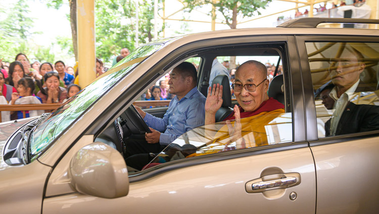 His Holiness the Dalai Lama waving to members of the crowd as he leaves the Main Tibetan Temple courtyard for his residence at the conclusion of his teaching for young Tibetans in Dharamsala, HP, India on June 3, 2019. Photo by Tenzin Choejor