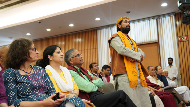 """A member of the audience listening to His Holiness the Dalai Lama answering his question during the conference on """"Celebrating Diversity in the Muslim World"""" at the India International Centre in New Delhi, India on June 15, 2019. Photo by Tenzin Choejor"""