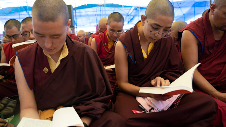 Nuns following the text during His Holiness the Dalai Lama's second day of teachings in Manali, HP, India on August 14, 2019. Photo by Tenzin Choejor