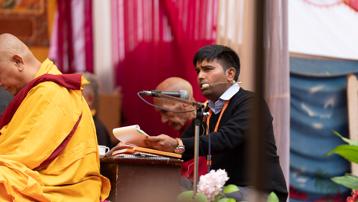 The Hindi interpreter translating His Holiness the Dalai Lama's comments on the second day of teachings in Manali, HP, India on August 14, 2019. Photo by Tenzin Choejor