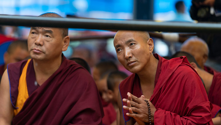 Members of the crowd watching as His Holiness the Dalai Lama performs preparatory rituals for the Empowerment of Mahakarunika Lokeshvara in Manali, HP, India on August 17, 2019. Photo by Tenzin Choejor