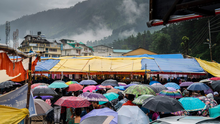 A view of the covered venue with an estimated 8000 people, some using umbrellas to protect agains the rain, during the Empowerment of Mahakarunika Lokeshvara given by His Holiness the Dalai Lama in Manali, HP, India on August 17, 2019. Photo by Tenzin Choejor