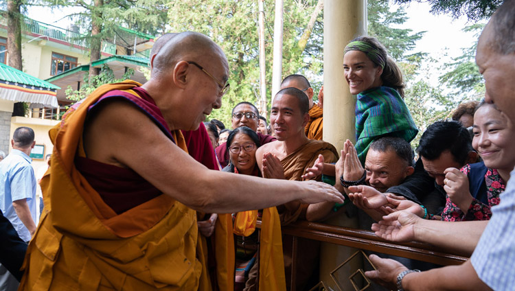 His Holiness the Dalai Lama greeting members of the crowd as he walks to the Main Tibetan Temple for the first day of teachings in Dharamsala, HP, India on September 4, 2019. Photo by Tenzin Choejor