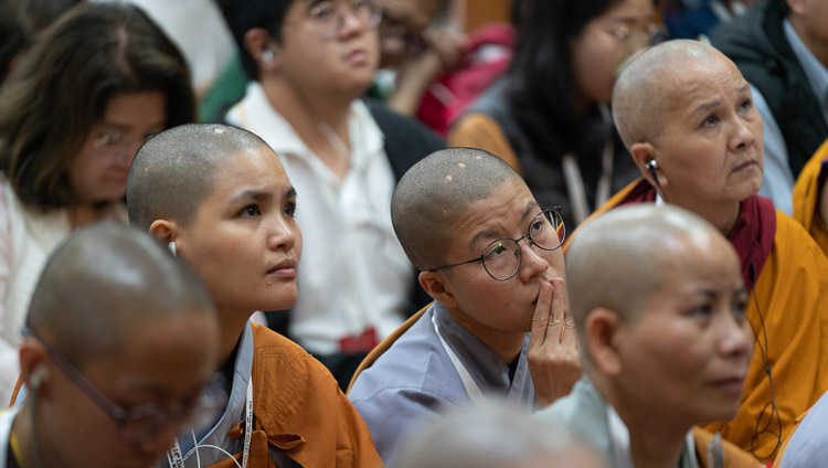 Members of the audience from Asia sitting inside the Main Tibetan Temple listening to His Holiness the Dalai Lama speaking on the first day of his teachings in Dharamsala, HP, India on September 4, 2019. Photo by Tenzin Choejor