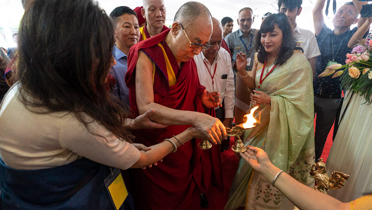 His Holiness the Dalai Lama lighting a lamp before taking his seat for his talk to students at Shri Ram School in New Delhi, India on September 20, 2019. Photo by Tenzin Choejor