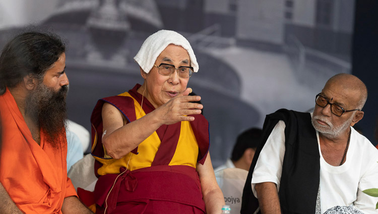 Baba Ramdev. and Morari Bapuji look on as His Holiness the Dalai Lama addresses the gathering during the interfaith program at Gandhi Ashram in New Delhi, India on September 25, 2019. Photo by Tenzin Choejor