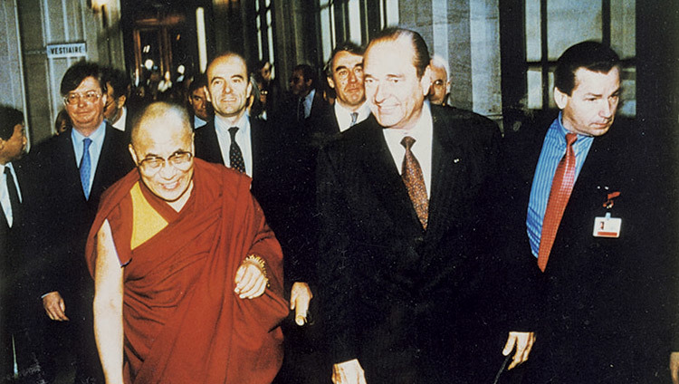 His Holiness the Dalai Lama walking with French President Jacques Chirac in Paris, France on December 8, 1998.