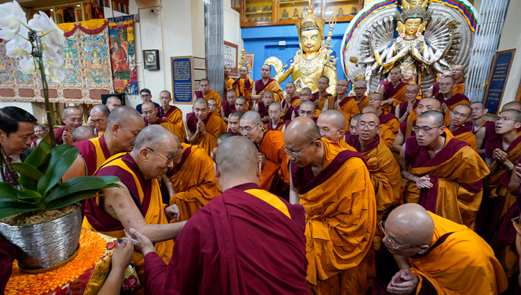 His Holiness the Dalai Lama greeting monks from Taiwan as he arrives for the second day of teachings at the Main Tibetan Temple in Dharamsala, HP, India on October 4, 2019. Photo by Ven Tenzin Jamphel