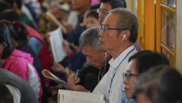 Members of the audience, some of the more than 1100 from Taiwan attending the teachings, listening to His Holiness the Dalai Lama at the Main Tibetan Temple in Dharamsala, HP, India on October 4, 2019. Photo by Ven Tenzin Jamphel