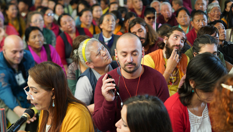 Members of the audience from over 61 countries listening to translations of His Holiness the Dalai Lama's final day of teachings at the Main Tibetan Temple in Dharamsala, HP, India on October 5, 2019. Photo by Ven Tenzin Jamphel