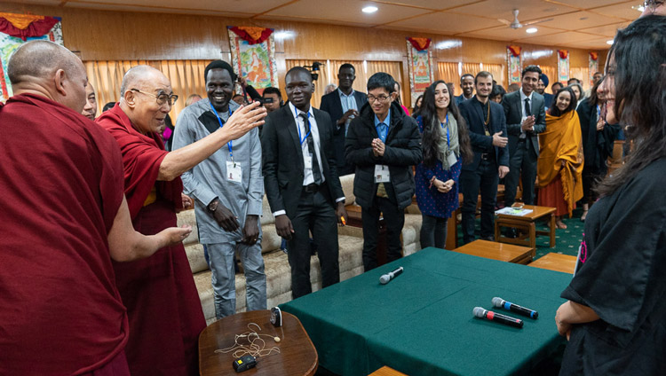 His Holiness the Dalai Lama greeting young people from conflict affected countries as he arrives for their conversation at his residence in Dharamsala, HP, India on October 23, 2019. Photo by Tenzin Choejor