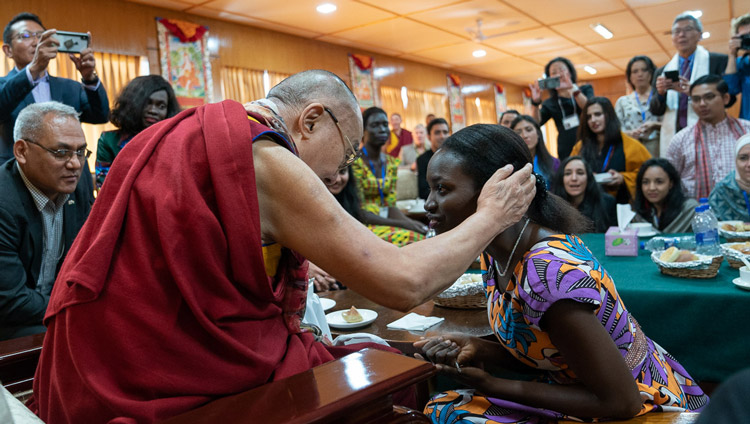 His Holiness the Dalai Lama thanking a young woman for participating in the conversation with young peacebuilders organized by the United States Institute of Peace at his residence in Dharamsala, HP, India on October 24, 2019. Photo by Tenzin Choejor