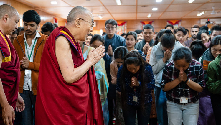 His Holiness the Dalai Lama greeting students from North Indian universities as he arrives from their meeting at his residence in Dharamsala, HP, India on October 25, 2019. Photo by Tenzin Choejor