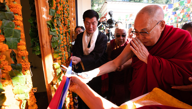 His Holiness the Dalai Lama cutting a ribbon to inaugurate the Tibetan Institute of Performing Arts' new auditorium in Dharamsala, India on October 29, 2019. Photo by Tenzin Choejor