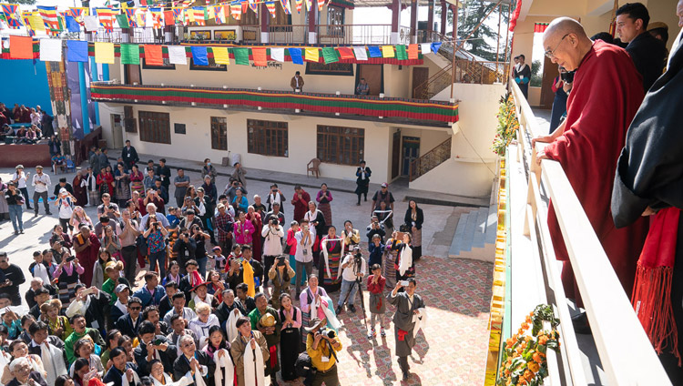His Holiness the Dalai Lama watching from the balcony as former TIPA artists and members of the public perform songs in the courtyard of the Tibetan Institute of Performing Arts in Dharamsala, India on October 29, 2019. Photo by Tenzin Choejor